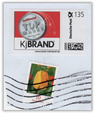 Abbildung 73a: Echte Marke auf Briefausschnitt mit Wellenstempel